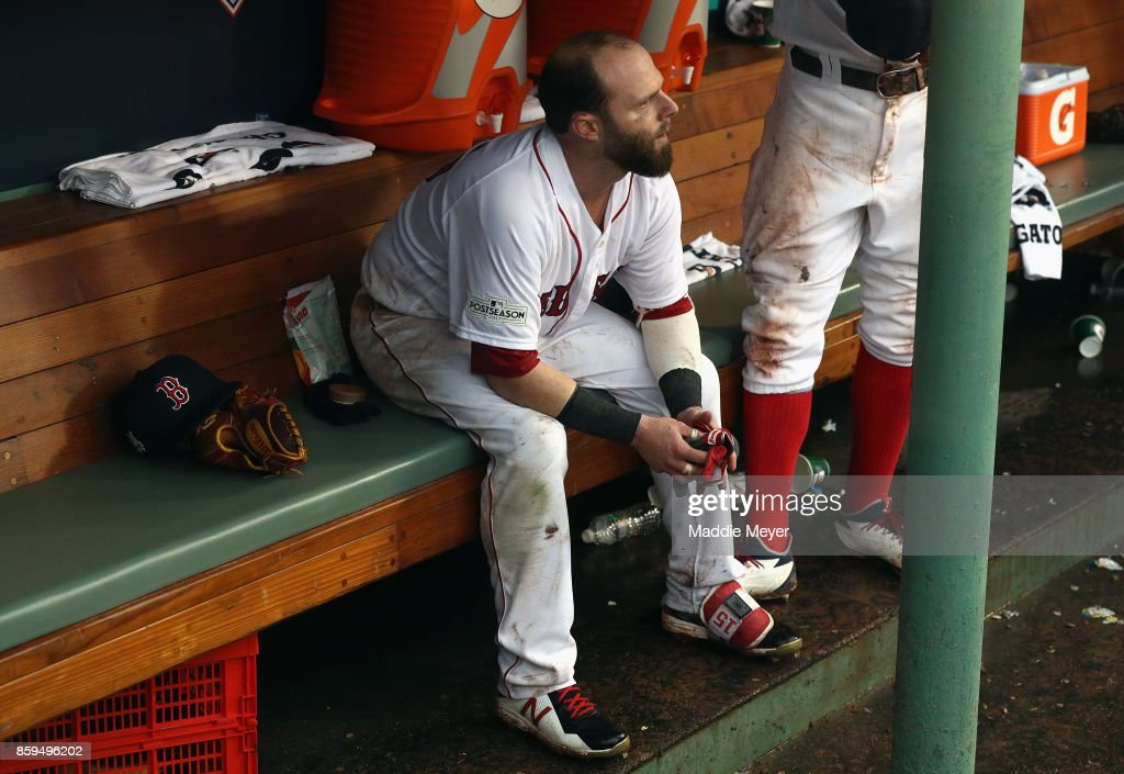 Dustin Pedroia #15 of the Boston Red Sox reacts in the dugout after being defeated by the Houston Astros 5-4 in game four of the American League Division Series at Fenway Park on October 9, 2017 in Boston, Massachusetts.