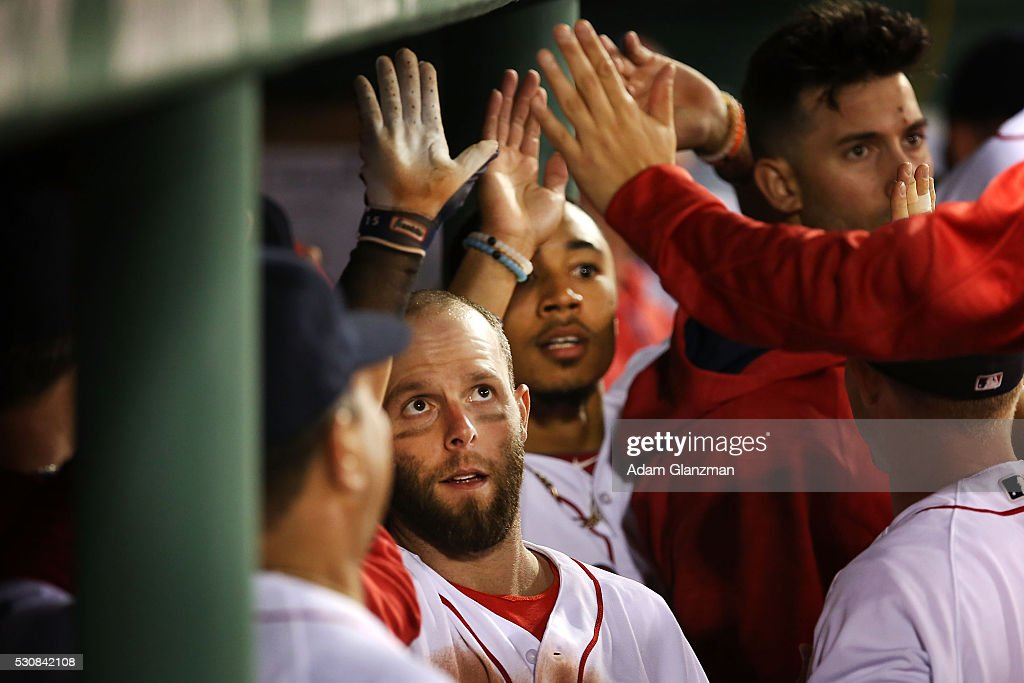 Dustin Pedroia #15 of the Boston Red Sox returns to the dugout after hitting a two-run home run in the fourth inning during the game against the Oakland Athletics at Fenway Park on May 11, 2016 in Boston, Massachusetts.