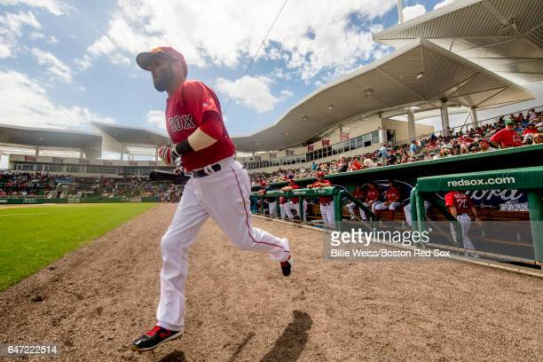 Dustin Pedroia of the Boston Red Sox runs onto the field before a Spring Training game against the Tampa Bay Rays on March 2 2017 at Fenway South in...