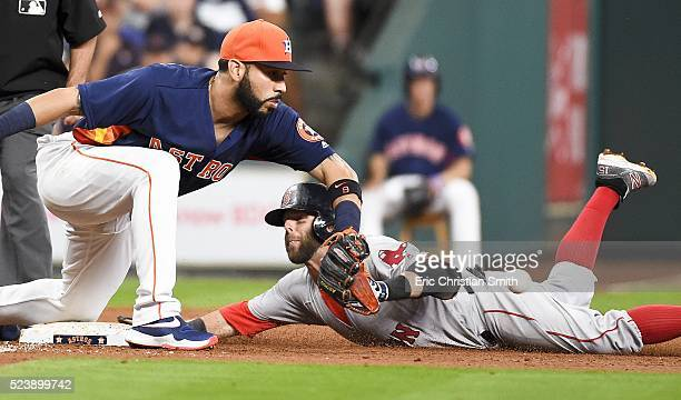 Dustin Pedroia of the Boston Red Sox slides safely into third for a triple past Marwin Gonzalez of the Houston Astros during the second inning at...