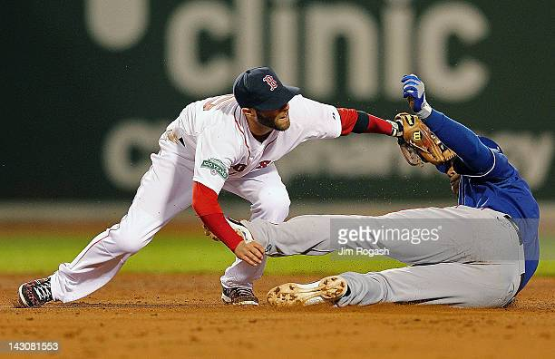 Dustin Pedroia of the Boston Red Sox tags out Elvis Andrus of the Texas Rangers, who tried to stretch a single into a double, at Fenway Park April...