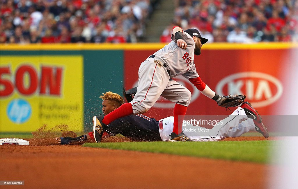 Dustin Pedroia #15 of the Boston Red Sox tags out Jose Ramirez #11 of the Cleveland Indians as he attempts to steal second base in the fifth inning during game two of the American League Divison Series at Progressive Field on October 7, 2016 in Cleveland, Ohio.
