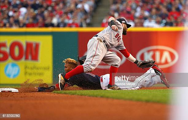Dustin Pedroia of the Boston Red Sox tags out Jose Ramirez of the Cleveland Indians as he attempts to steal second base in the fifth inning during...