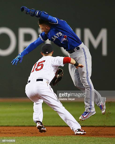 Dustin Pedroia of the Boston Red Sox tags out Josh Donaldson of the Toronto Blue Jays at second during the first inning at Fenway Park on September 9...