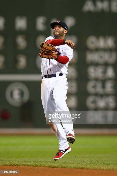 Dustin Pedroia of the Boston Red Sox throws to first base during a game against the Chicago Cubs at Fenway Park on April 30 2017 in Boston...
