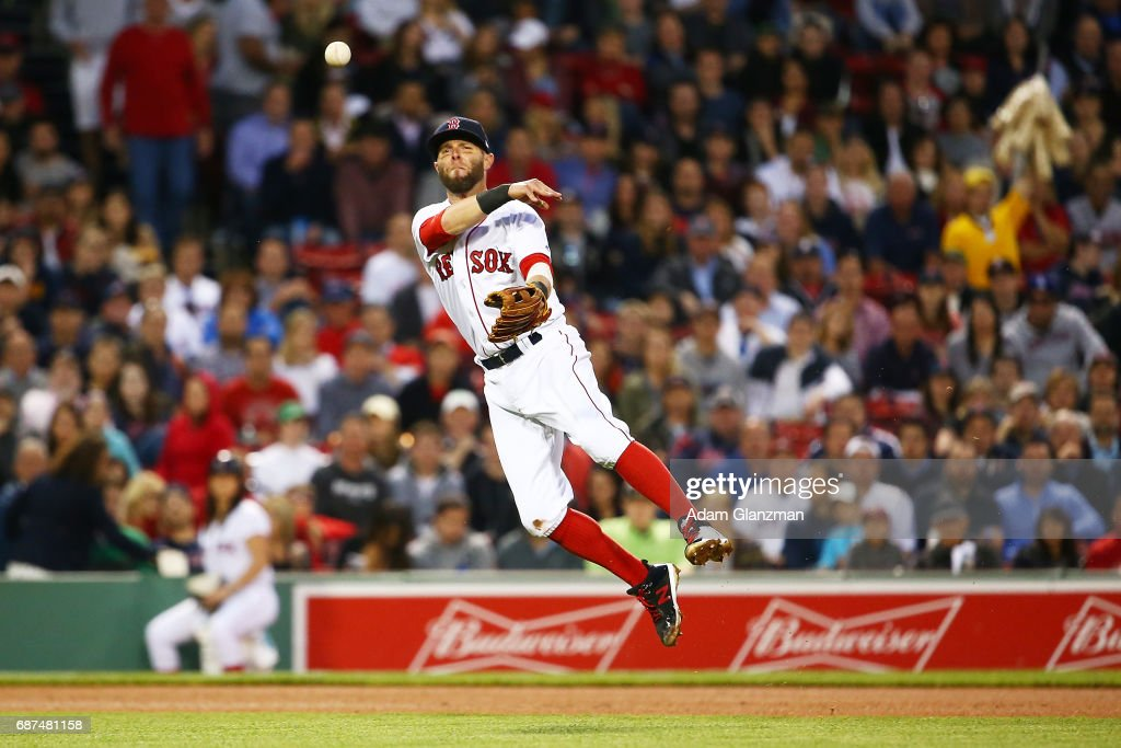 Dustin Pedroia #15 of the Boston Red Sox throws to first base in the fourth inning of a game against the Texas Rangers at Fenway Park on May 23, 2017 in Boston, Massachusetts.