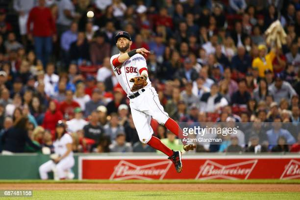 Dustin Pedroia of the Boston Red Sox throws to first base in the fourth inning of a game against the Texas Rangers at Fenway Park on May 23 2017 in...