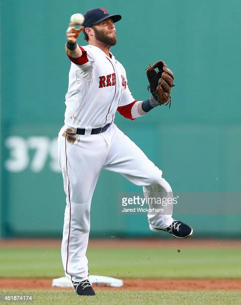Dustin Pedroia of the Boston Red Sox throws to first base in the first inning against the Chicago White Sox during the game at Fenway Park on July 8...