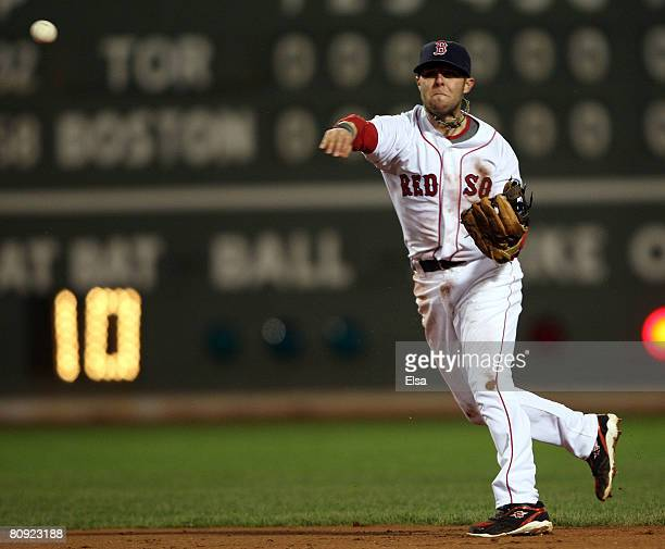 Dustin Pedroia of the Boston Red Sox throws to first for the out in the ninth inning against the Toronto Blue Jays on April 29 2008 at Fenway Park in...