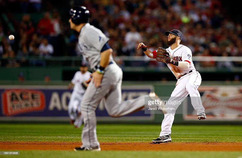 Dustin Pedroia #15 of the Boston Red Sox turns a double play in the seventh inning against the Tampa Bay Rays during Game Two of the American League Division Series at Fenway Park on October 5, 2013 in Boston, Massachusetts.