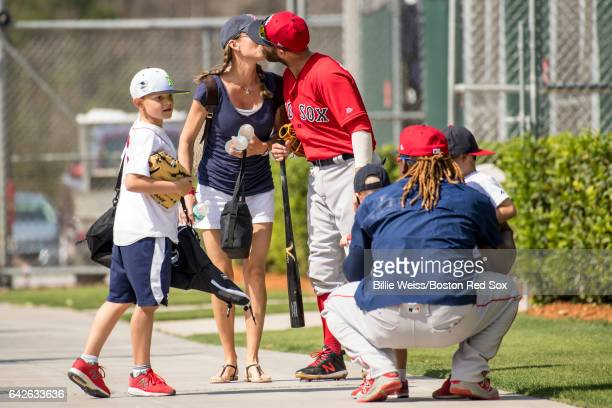 Dustin Pedroia of the Boston Red Sox walks off the field with family during a team workout on February 18 2017 at Fenway South in Fort Myers Florida