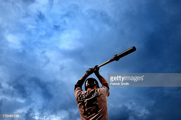 Dustin Pedroia of the Boston Red Sox warmsup on deck before batting against the Baltimore Orioles in the fourth inning at Oriole Park at Camden Yards...