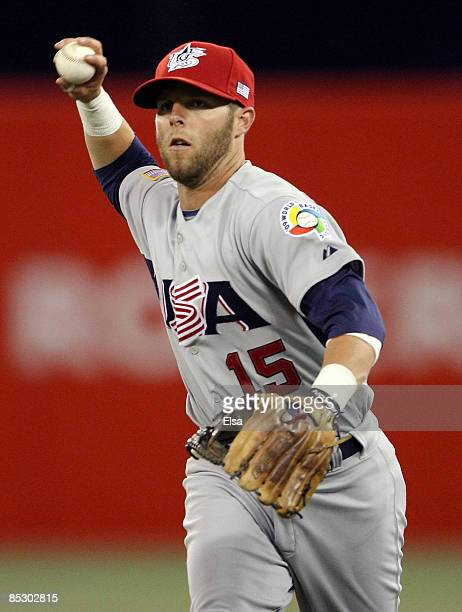 Dustin Pedroia of the USA sends the ball to first for the out against Venezuela during the 2009 World Baseball Classic Pool C match on March 8 2009...