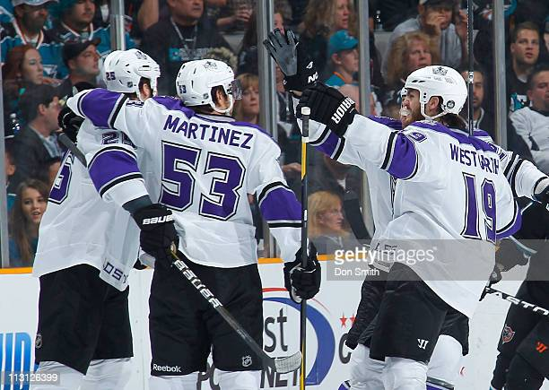 Dustin Penner, Alec Maritnez and Kevin Westgarth of the Los Angeles Kings celebrate against the San Jose Sharks in Game 5 of the Western Conference...