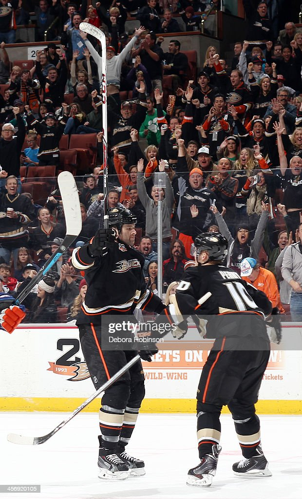 Dustin Penner #17 of the Anaheim Ducks celebrates with teammate Corey Perry #10 after scoring the go ahead goal in the third period against the Edmonton Oilers on December 15, 2013 at Honda Center in Anaheim, California.