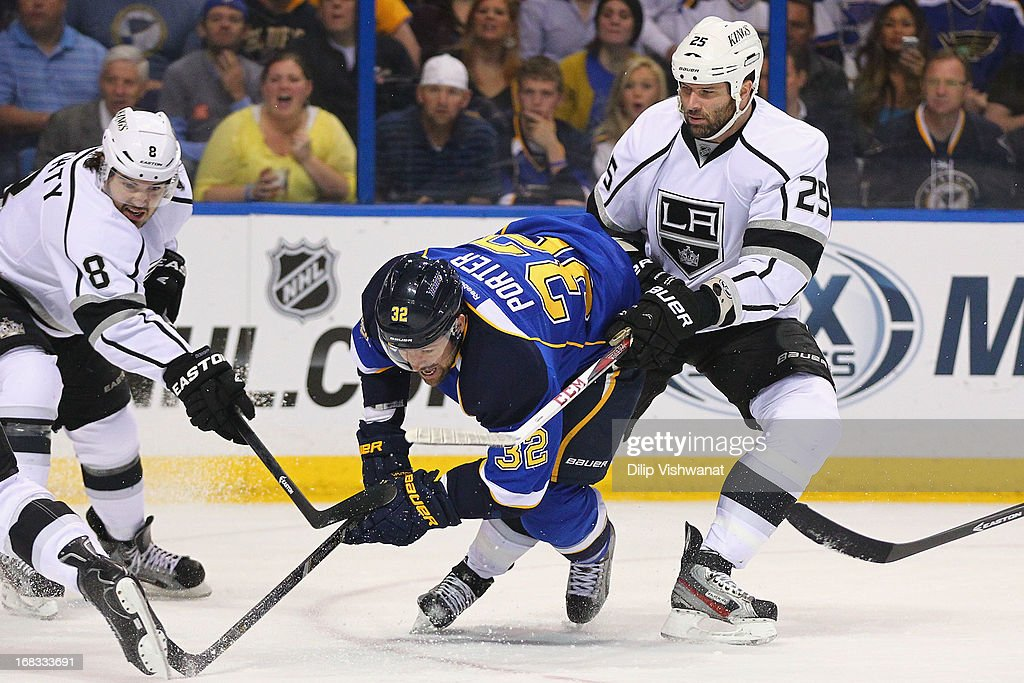 Dustin Penner #25 of the Los Angeles Kings pushes Chris Porter #32 of the St. Louis Blues to the ice in Game Five of the Western Conference Quarterfinals during the 2013 NHL Stanley Cup Playoffs at the Scottrade Center on May 8, 2013 in St. Louis, Missouri.