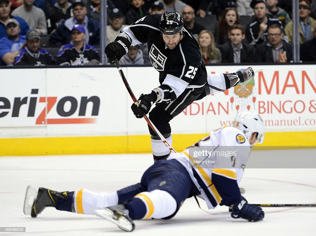 Dustin Penner #25 of the Los Angeles Kings shoots over a sliding Shea Weber #6 of the Nashville Predators at Staples Center on March 4, 2013 in Los Angeles, California.