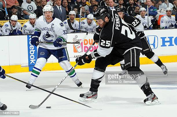 Dustin Penner of the Los Angeles Kings skates with the puck against the Vancouver Canucks in Game Four of the Western Conference Quarterfinals during...