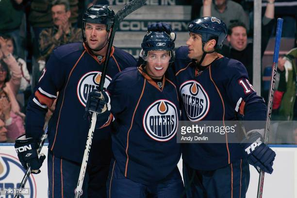 Dustin Penner Sam Gagner and Jarret Stoll of the Edmonton Oilers celebrate a goal against the Calgary Flames at Rexall Place on February 4 2008 in...