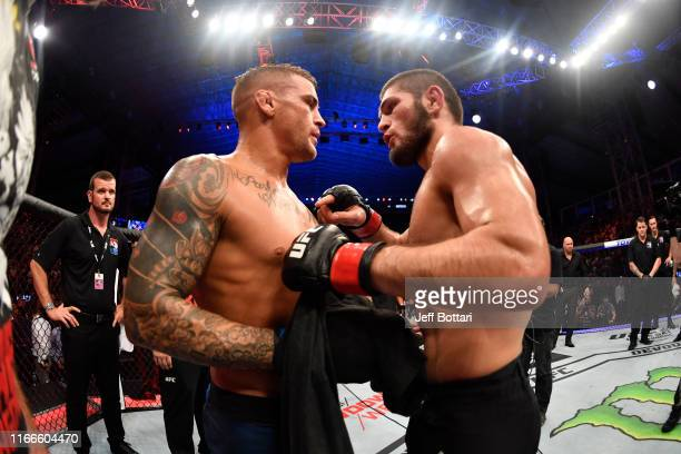Dustin Poirier and Khabib Nurmagomedov of Russia embrace after their lightweight championship bout during UFC 242 at The Arena on September 7 2019 in...