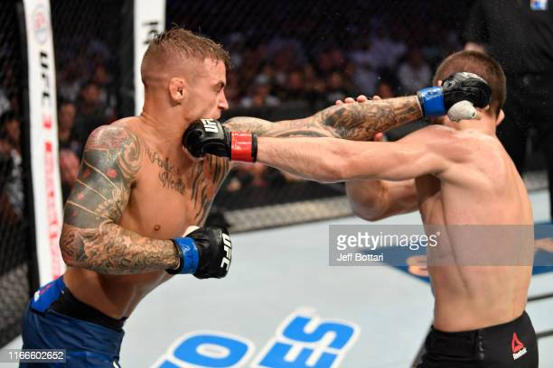 Dustin Poirier and Khabib Nurmagomedov of Russia exchange punches in their lightweight championship bout during UFC 242 at The Arena on September 7...
