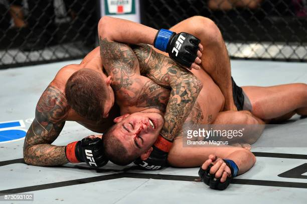 Dustin Poirier attempts to submit Anthony Pettis in their lightweight bout during the UFC Fight Night event inside the Ted Constant Convention Center...
