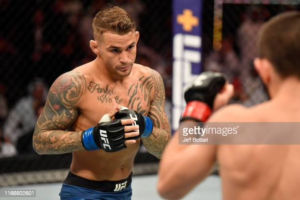 Dustin Poirier battles Khabib Nurmagomedov of Russia in their lightweight championship bout during UFC 242 at The Arena on September 7 2019 in Yas...