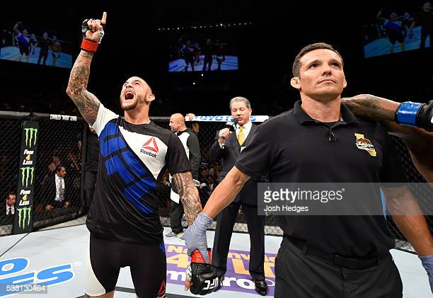 Dustin Poirier celebrates after his TKO win in the frist round against Bobby Green in their lightweight bout during the UFC 199 event at The Forum on...