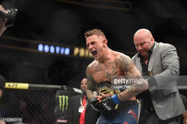 Dustin Poirier celebrates after recieving the title belt from UFC President Dana White during the UFC 236 event at State Farm Arena on April 13 2019...