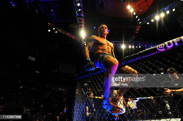 Dustin Poirier celebrates by jumping on top of the octagon during the UFC 236 event at State Farm Arena on April 13 2019 in Atlanta Georgia