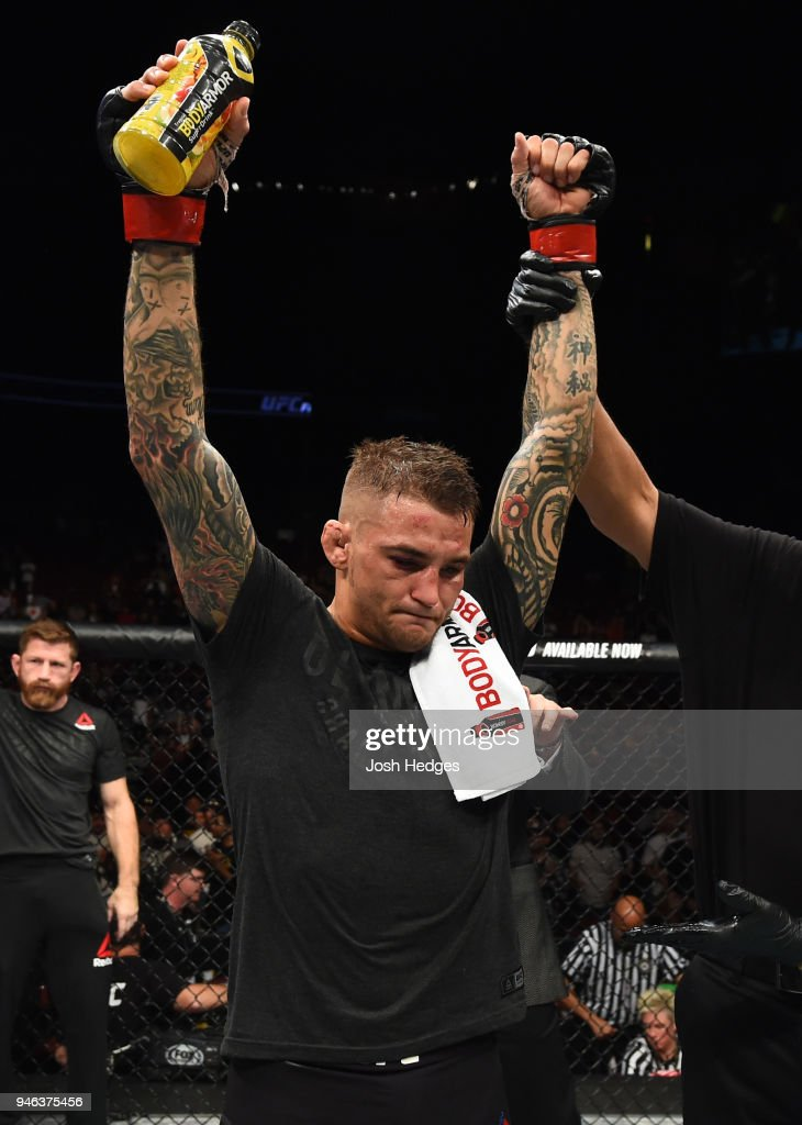 Dustin Poirier celebrates his victory over Justin Gaethje in their lightweight fight during the UFC Fight Night event at the Gila Rivera Arena on April 14, 2018 in Glendale, Arizona.