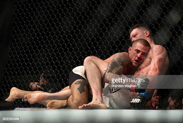 Dustin Poirier controls the body of Joe Duffy of Ireland in their lightweight bout during the UFC 195 event inside MGM Grand Garden Arena on January...