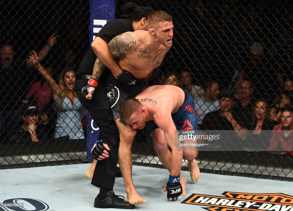 Dustin Poirier defeats Justin Gaethje in their lightweight fight during the UFC Fight Night event at the Gila Rivera Arena on April 14, 2018 in Glendale, Arizona.