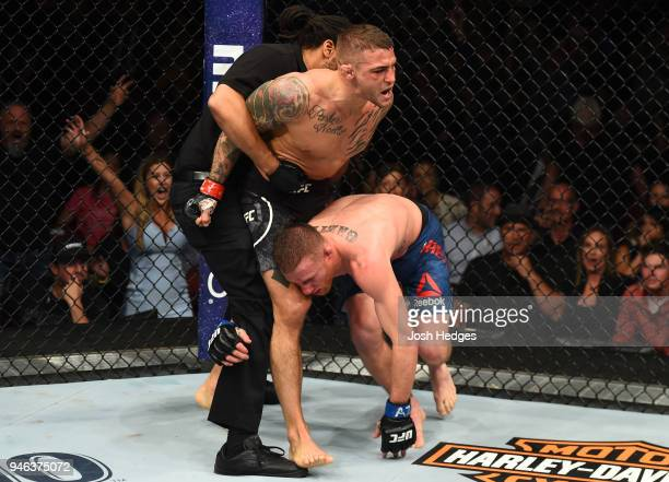 Dustin Poirier defeats Justin Gaethje in their lightweight fight during the UFC Fight Night event at the Gila Rivera Arena on April 14 2018 in...