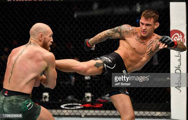 Dustin Poirier kicks Conor McGregor of Ireland in a lightweight fight during the UFC 257 event inside Etihad Arena on UFC Fight Island on January 23,...