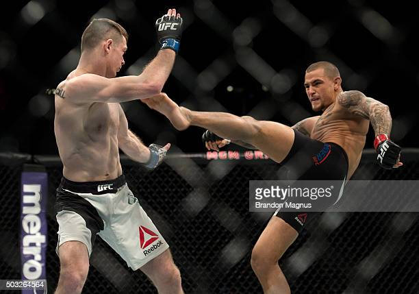 Dustin Poirier kicks Joe Duffy of Ireland in their lightweight bout during the UFC 195 event inside MGM Grand Garden Arena on January 2 2016 in Las...