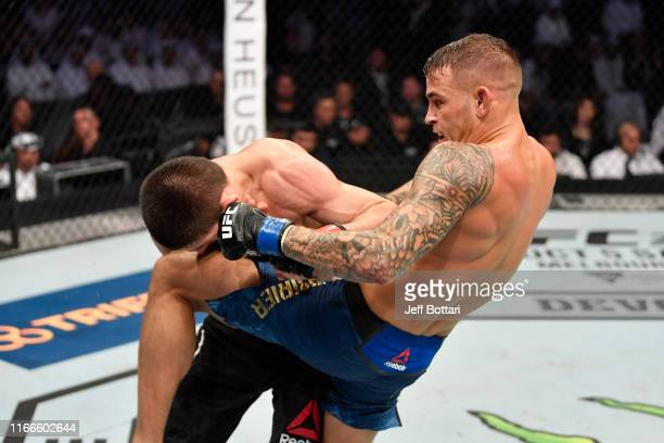 Dustin Poirier knees Khabib Nurmagomedov of Russia in their lightweight championship bout during UFC 242 at The Arena on September 7 2019 in Yas...