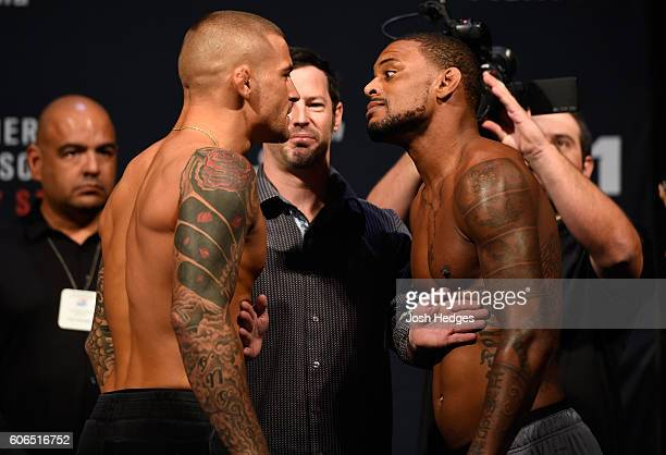 Dustin Poirier of the United States and Michael Johnson of the United States face off during the UFC Fight Night weighin at the State Farm Arena on...