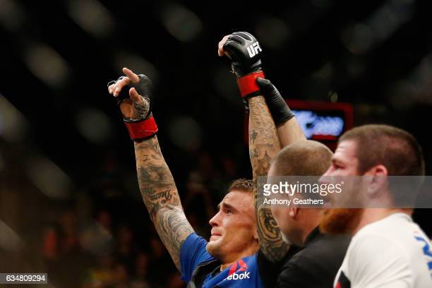 Dustin Poirier of United States is announced the winner by majority decision against Jim Miller of United States in their lightweight bout during UFC...