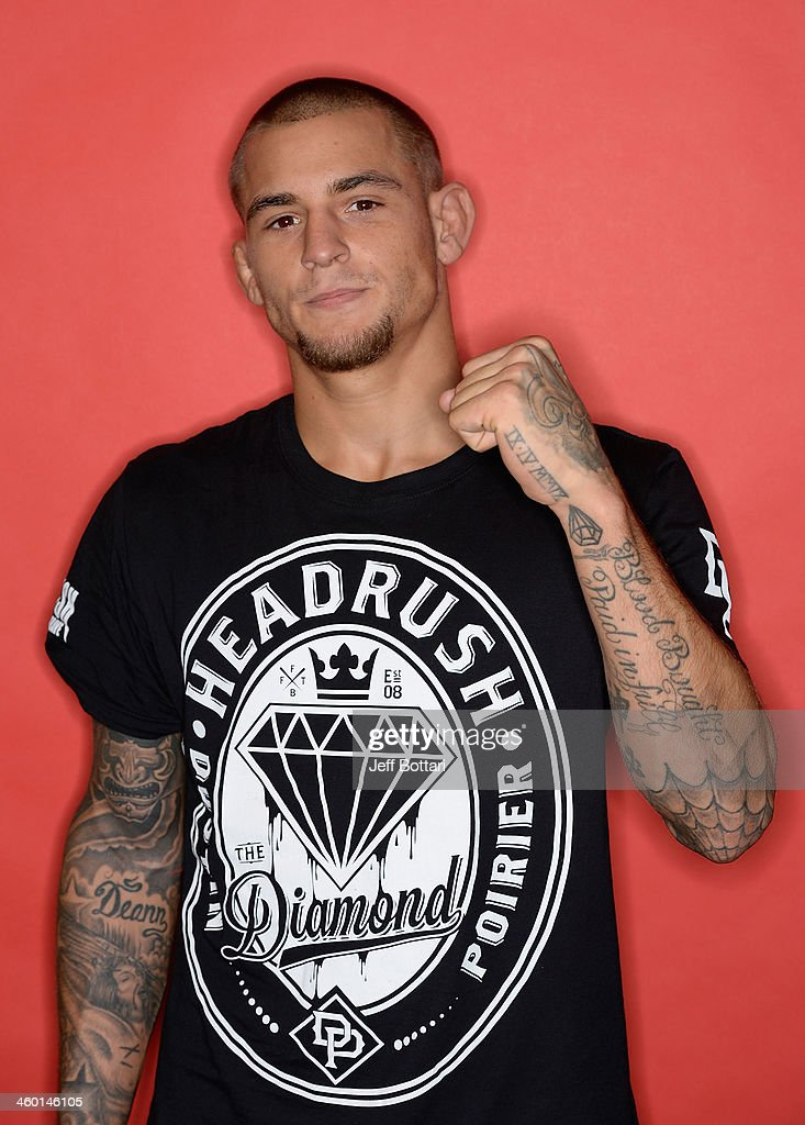 Dustin Poirier poses for a portrait after defeating Diego Brandao in their featherweight bout during the UFC 168 event at the MGM Grand Garden Arena on December 28, 2013 in Las Vegas, Nevada.