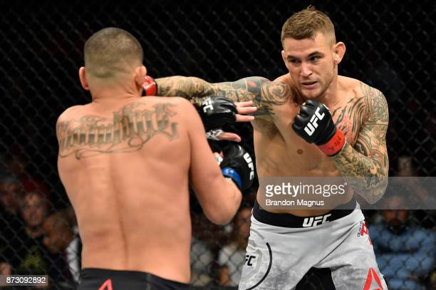 Dustin Poirier punches Anthony Pettis in their lightweight bout during the UFC Fight Night event inside the Ted Constant Convention Center on...