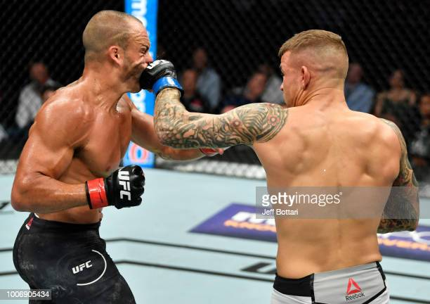 Dustin Poirier punches Eddie Alvarez in their lightweight bout during the UFC Fight Night event at Scotiabank Saddledome on July 28, 2018 in Calgary,...