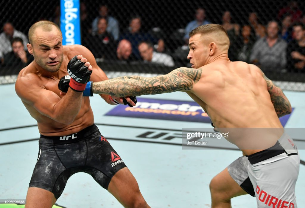 Dustin Poirier punches Eddie Alvarez in their lightweight bout during the UFC Fight Night event at Scotiabank Saddledome on July 28, 2018 in Calgary, Alberta, Canada.