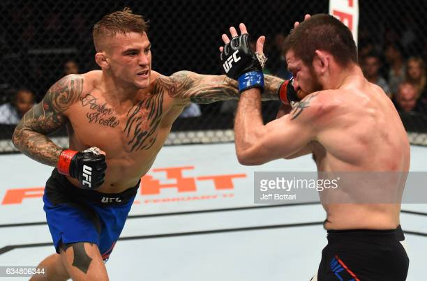 Dustin Poirier punches Jim Miller in their lightweight bout during the UFC 208 event inside Barclays Center on February 11 2017 in Brooklyn New York