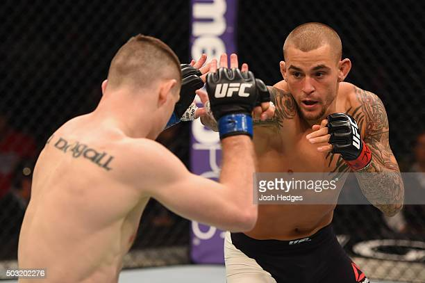 Dustin Poirier punches Joe Duffy of Ireland in their lightweight bout during the UFC 195 event inside MGM Grand Garden Arena on January 2 2016 in Las...