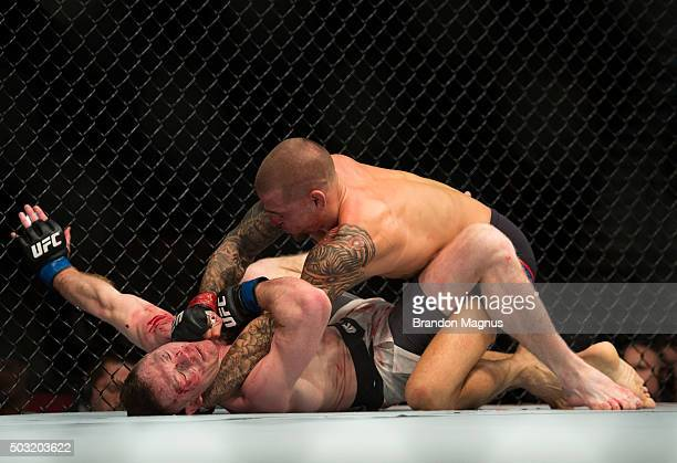 Dustin Poirier punches Joe Duffy of Ireland in their lightweight bout during the UFC 195 event inside MGM Grand Garden Arena on January 2, 2016 in...