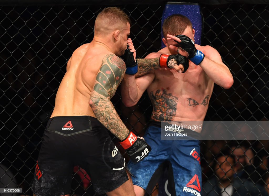 Dustin Poirier punches Justin Gaethje in their lightweight fight during the UFC Fight Night event at the Gila Rivera Arena on April 14, 2018 in Glendale, Arizona.