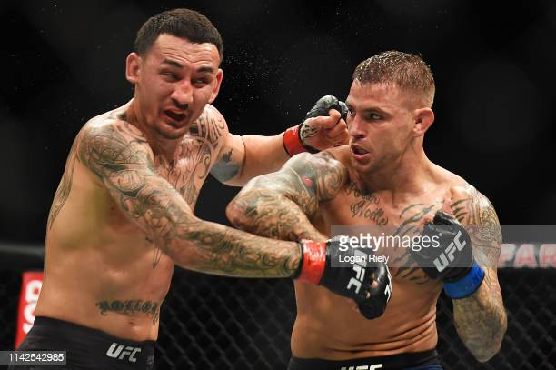 Dustin Poirier punches Max Holloway during the UFC 236 event at State Farm Arena on April 13 2019 in Atlanta Georgia