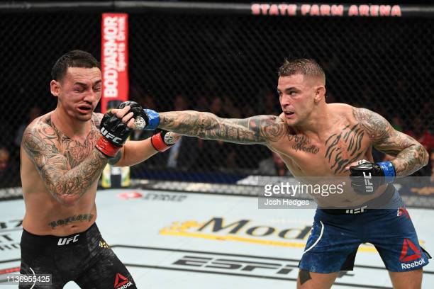 Dustin Poirier punches Max Holloway in their interim lightweight championship bout during the UFC 236 event at State Farm Arena on April 13 2019 in...