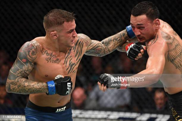 Dustin Poirier punches Max Holloway in their interim lightweight championship bout during the UFC 236 event at State Farm Arena on April 13, 2019 in...